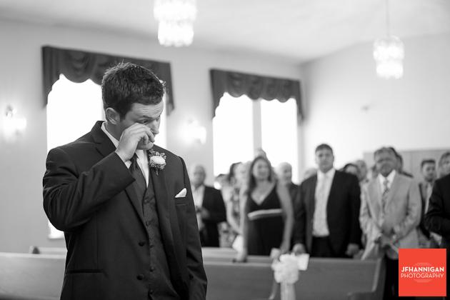 groom wipes away tear