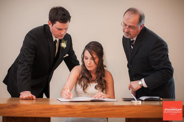 bride signs register