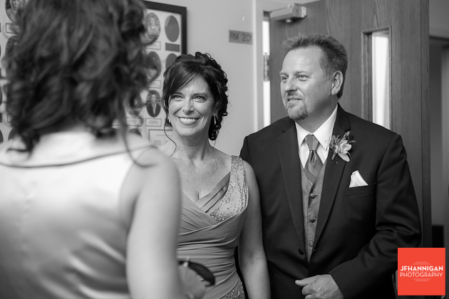groom's parents greet wedding guests
