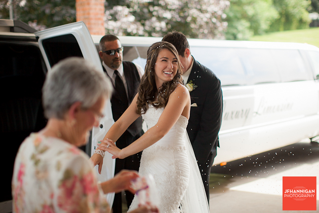bride and groom enter limo confetti the in air