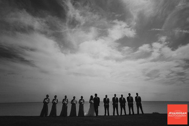 wedding party photo at lake front