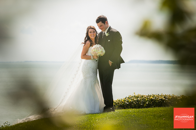 bride and groom positioned on lake front