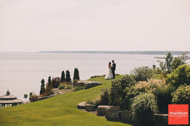 bride and groom in park beside lake