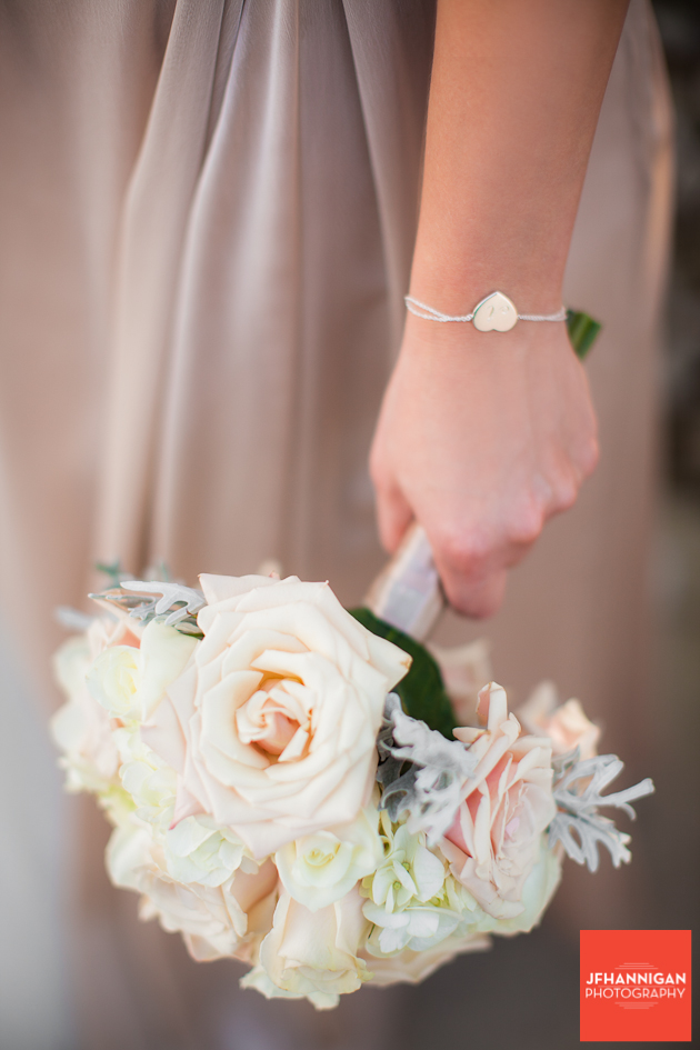 bridesmaid bouquet of roses and heart shaped bracelet