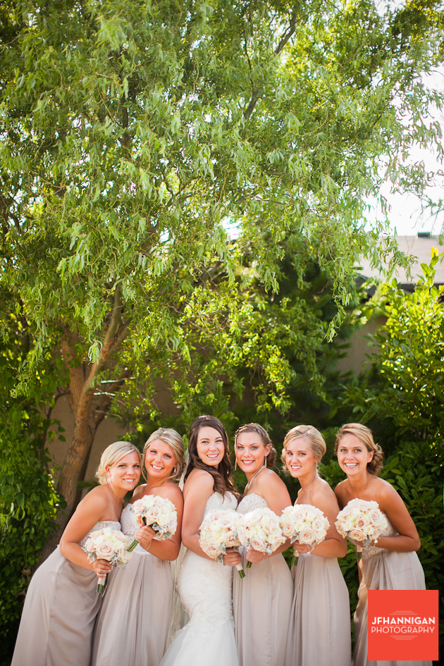 bridal party positioned in front of tree