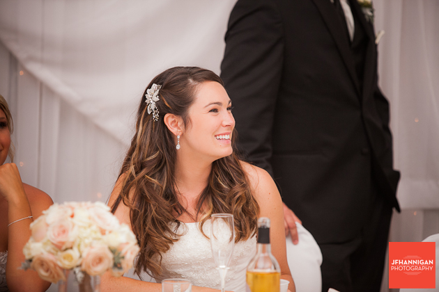 bride siiting at reception table