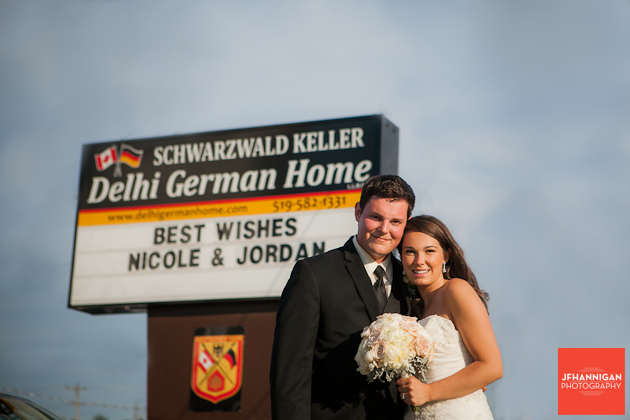 bride and groom pictured with reception hall sign