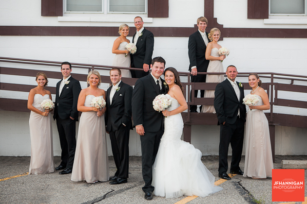 wedding party on chair ramp into reception hall