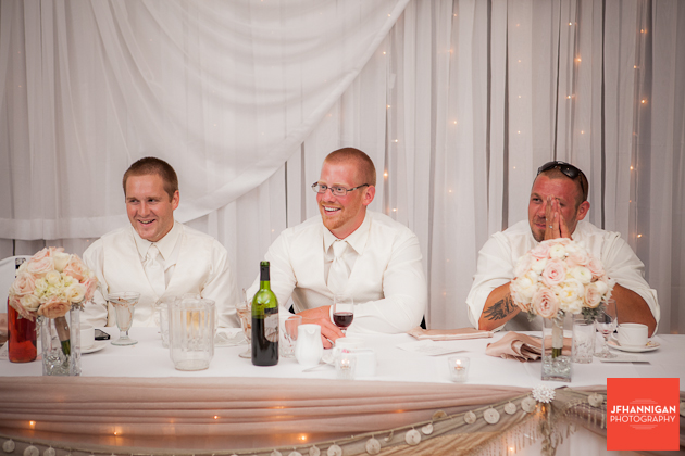 ushers sitting at head table of reception