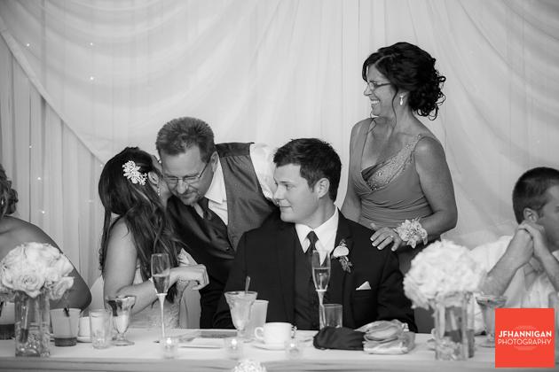 groom's parents greet bride after speech