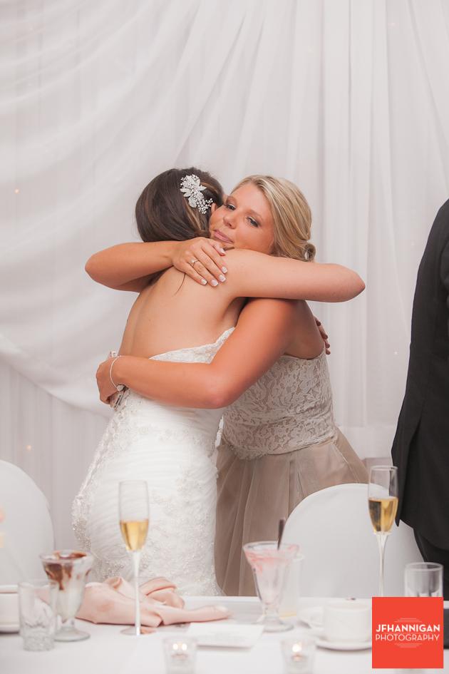 bride hugging bridesmaid following speech