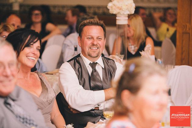 groom's parents enjoy reception speech