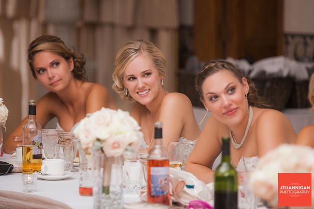 bridesmaids enjoy reception speech