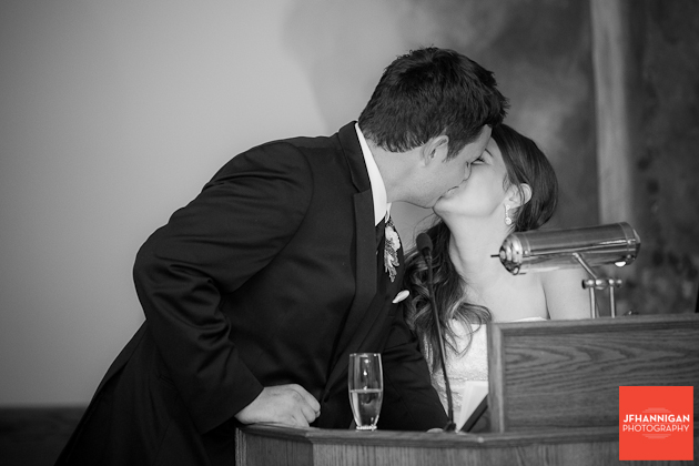 bride and groom kiss following reception speech