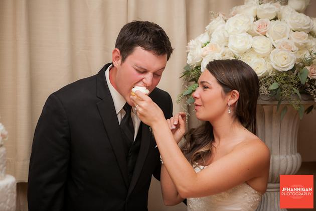 bride feeds grrom wedding cake