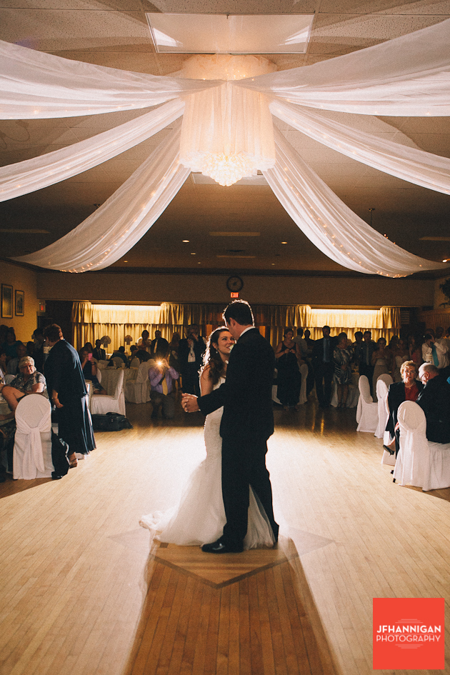 bride and grooms first dance under canopy