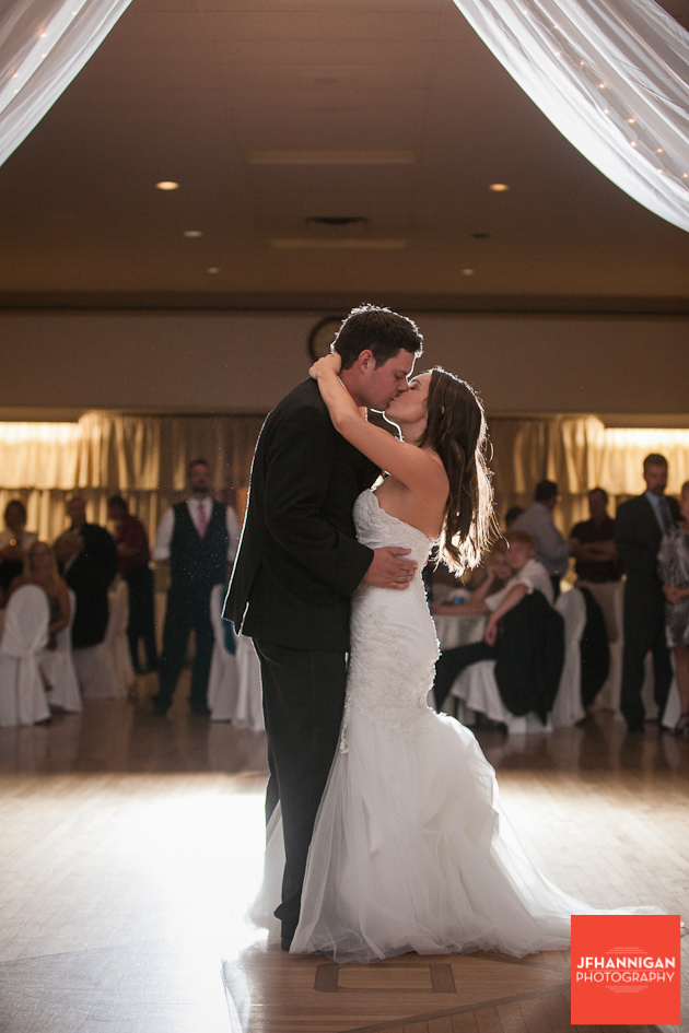 bride and groom kiss following first dance