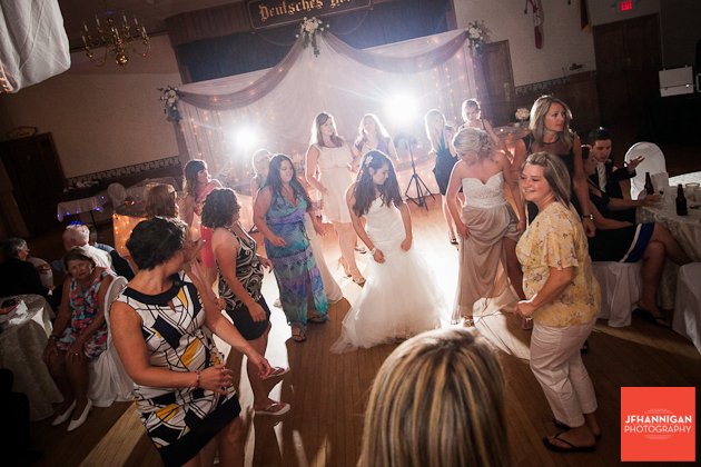 bride and friends dance