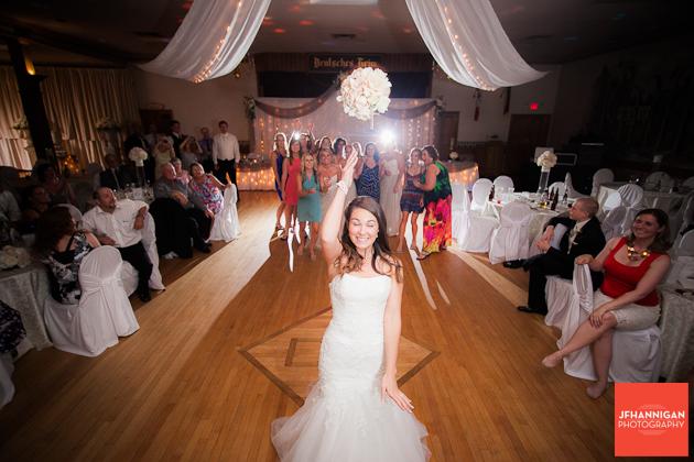 bride tosses bouquet