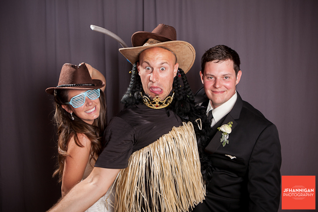 birde and groom with photographer in photobooth