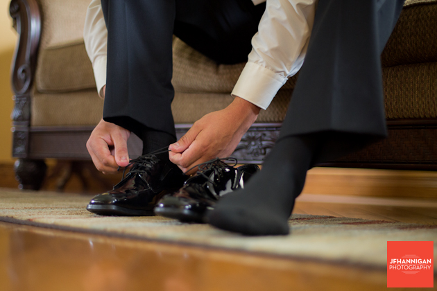 groom tying shoe laces