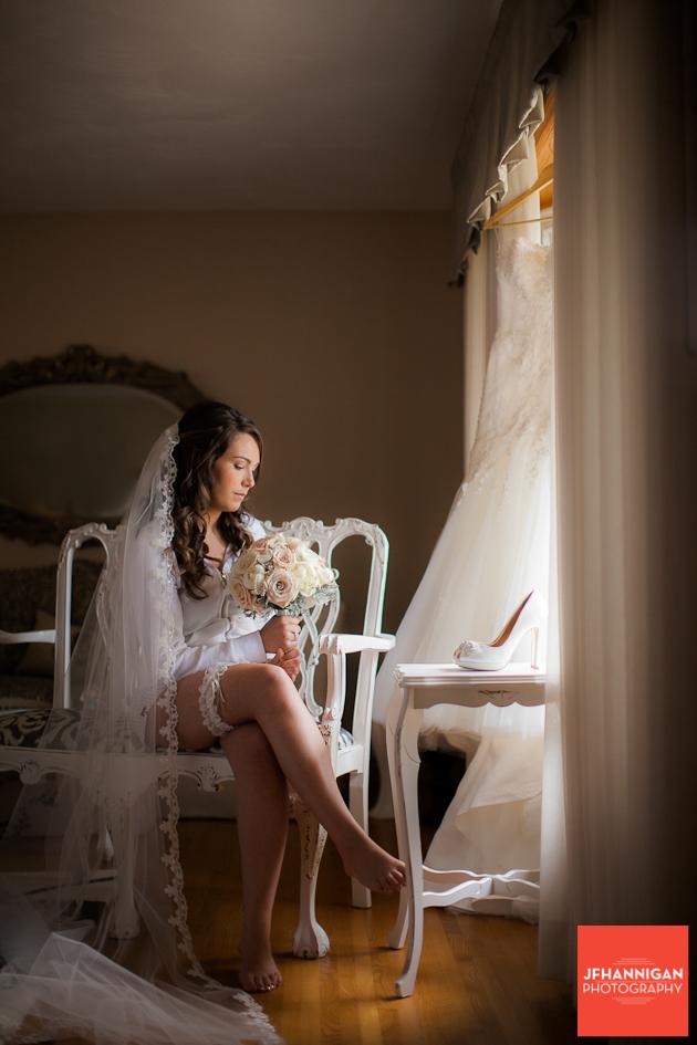 bride sitting by window Niagara Wedding Photographer
