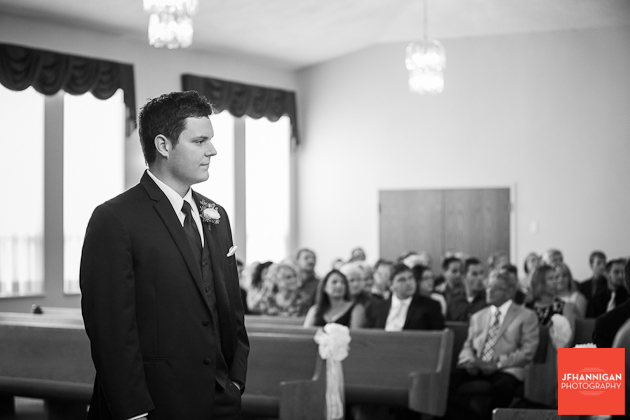 groom watches bridal party entrances