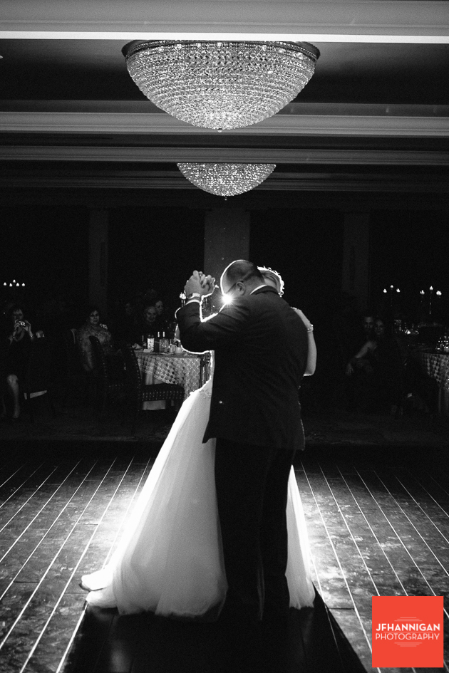 black an white of first dance with back light