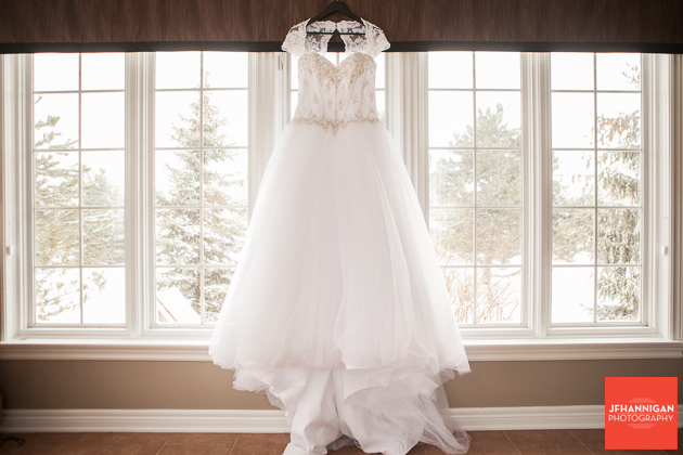 bride's gown with snow covered pines in background