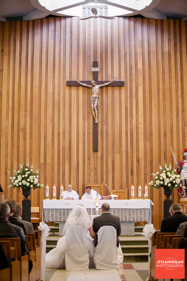 bride and groom seated at church altar