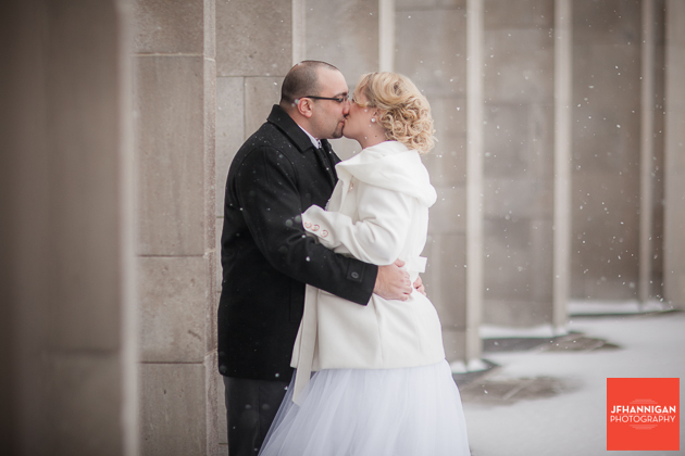 bride and groom kissing in snow at Mather's Arch