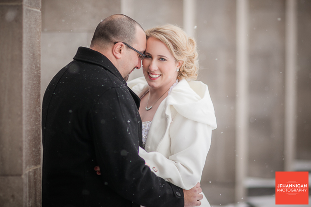 bride and groom at Mather's Arch in snow