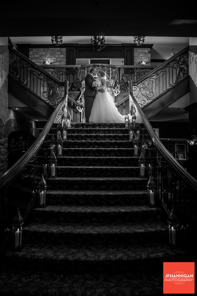 bride and groom at top of staircase black and white photo Niagara Wedding Photographer