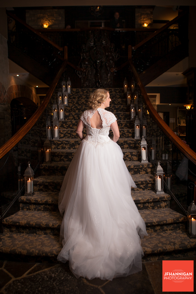 bride on staircase showing back of gown