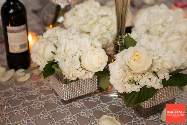 white hydrangea and roses table center pieces
