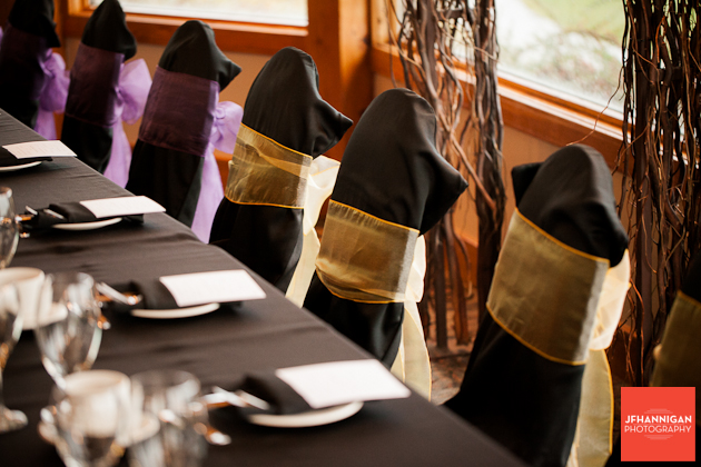head table with black chair covers