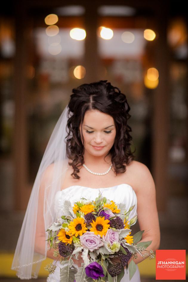 bride looking down a bouquet