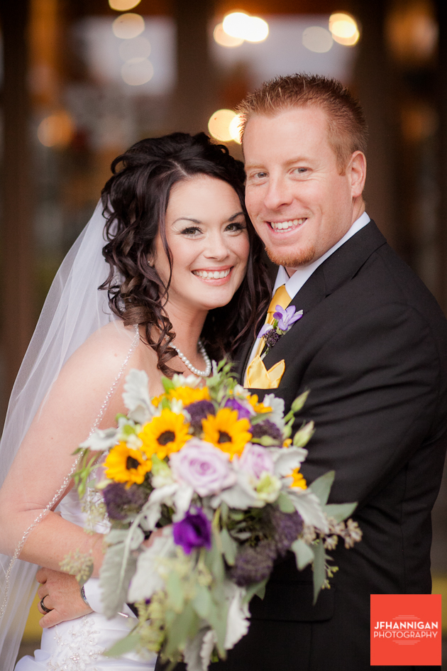 bride and groom portrait with mauve and yellow flowers