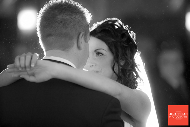bride looks into groom's eyes during first dance