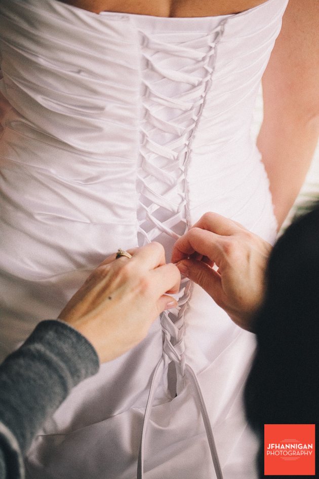 lacing up the bridal gown