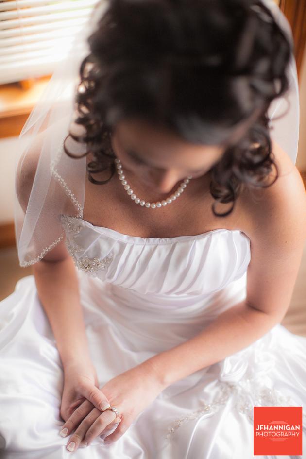 bride looks at rings