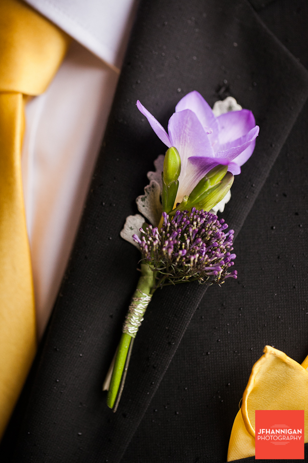 groom's boutineer in purple with yellow accents