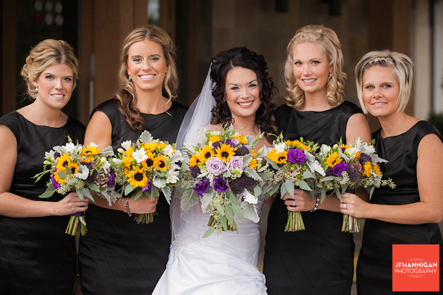 bride with attendents in black bouquet in yellow and purple