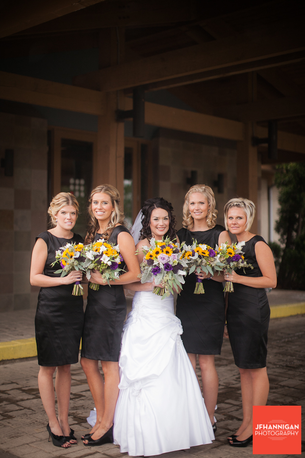 bride and bridesmaids in black yellow and purple