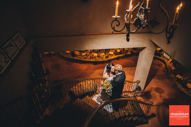 bride and groom on cirular staircase