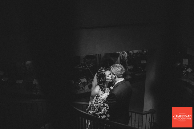 black and white of bride and groom kissing