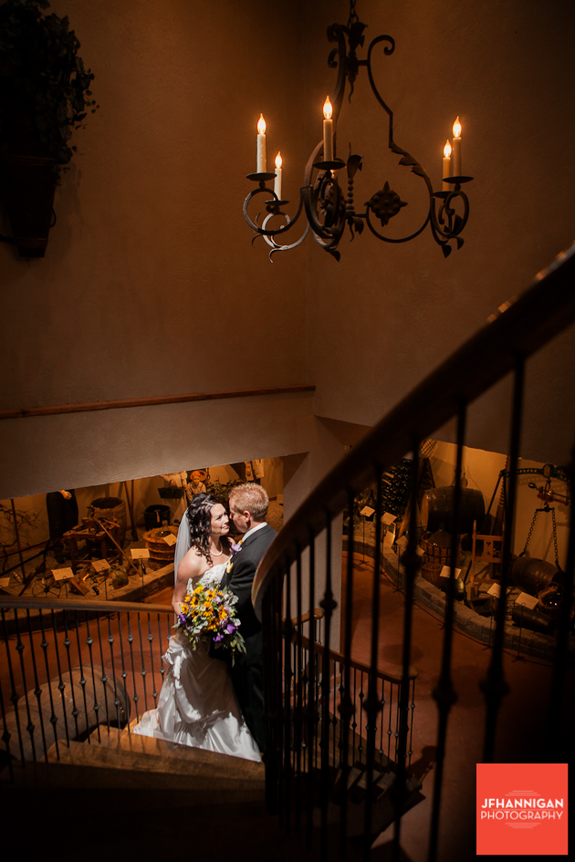 bride and groom on circular staircase