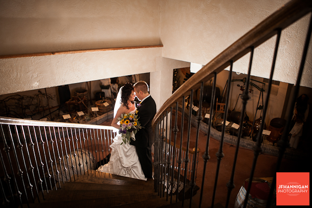 bride and groom on staircase with back lighting