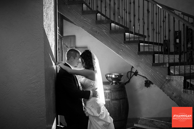 bride and groom with back light staircase in background