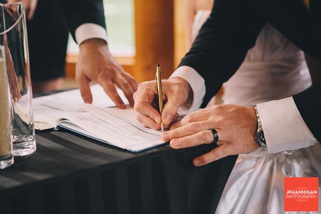 groom signs register